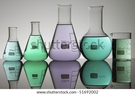 five glasses laboratory on a white background - stock photo