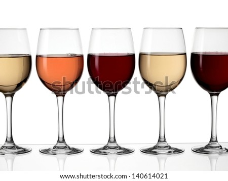 Five glasses with red, white and rose wine in line - stock photo