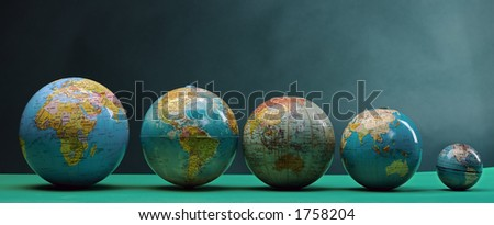 five globes lined up - stock photo