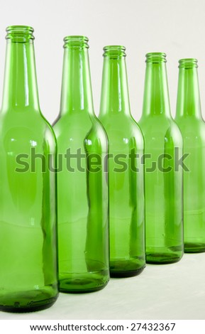 Five green bottles arranged in a line
