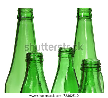 Five green glass bottles isolated on a white background