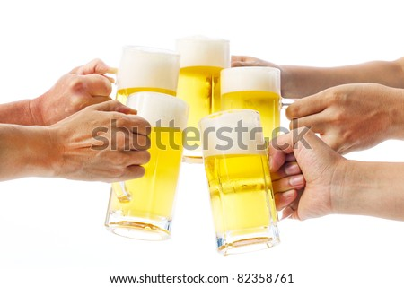 five hands holding beers making a toast - stock photo