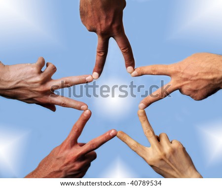 Five hands with different skin-color, their fingers building a star - stock photo