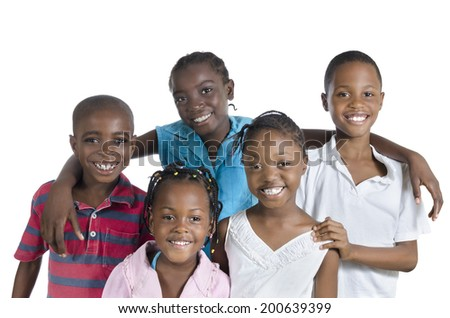Five happy african kids holding one another, Studio Shot