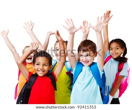 Five happy children with their hands up - stock photo