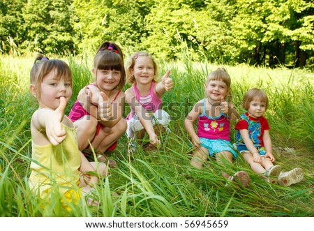 Five happy friends having fun in the outdoor - stock photo