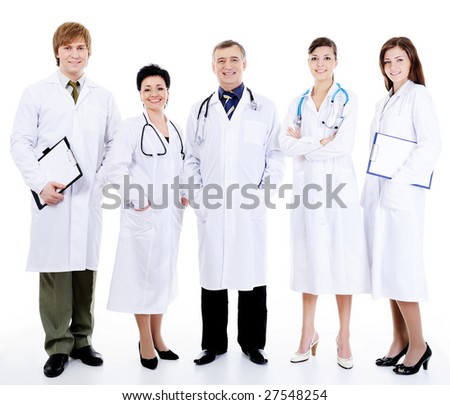 five happy successful smiling doctors standing together in row