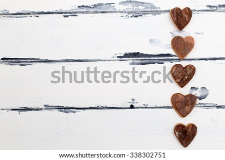 five heart shaped bark decoration on vintage background - stock photo