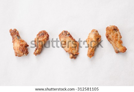 Five Hot Chicken Wings on a White Background Top View - stock photo