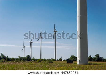 Five Huge Wind Turbines in Rural Field - stock photo