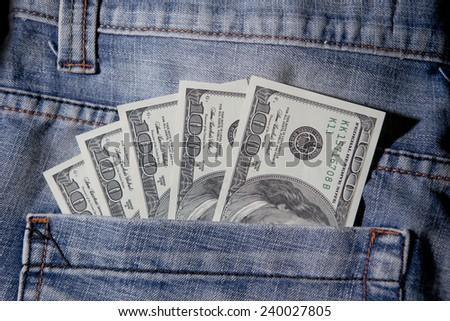 Five hundred Dollars in back pocket of blue jeans - stock photo