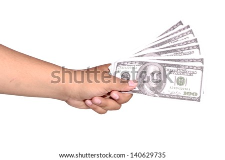 five hundred dollars in the grip of the left hand, isolated on white background