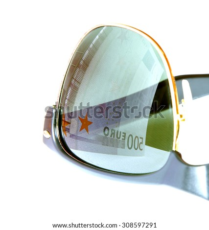 five hundred euro reflected in sunglasses of greedy man eyes - stock photo