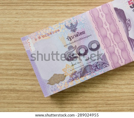 five hundred  thai banknotes put on table .  money concept - stock photo