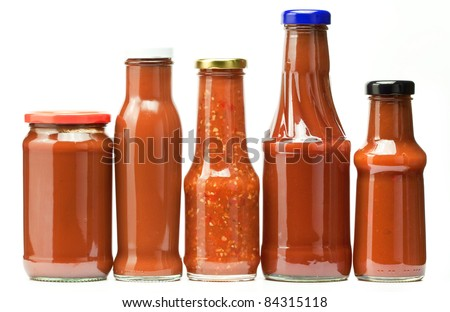 five ketchup bottles isolated on white - stock photo