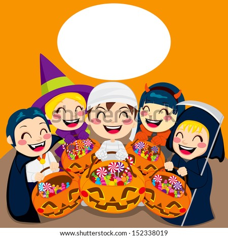 Five kids with Halloween pumpkin bags full of sweets and candy from Trick or Treat and copy space for text - stock photo