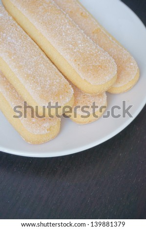 Five ladyfingers served on white plate