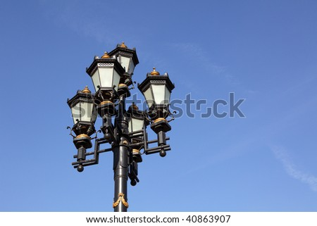 Five lamps on a high metal lamppost