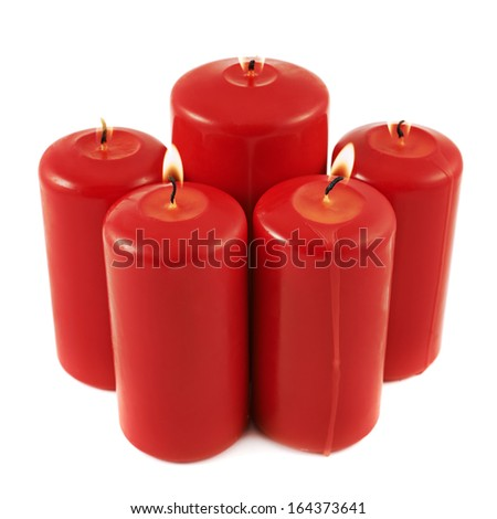 Five lighted candles composition isolated over white background - stock photo