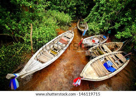 Five Long-tailed boat at mangrove forest in Thailand - stock photo