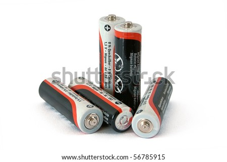 Five low-cost batteries on white background - stock photo