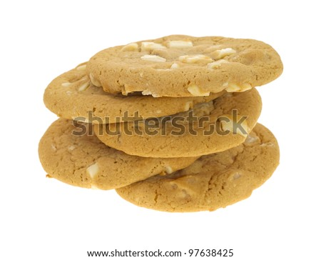 Five macadamia nut and white chocolate cookies in a sloppy stack on a white background.