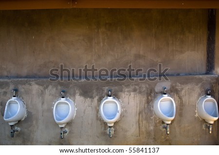 five men toilet at the outdoor of hotel - stock photo