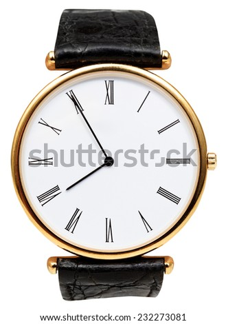 five minutes to eight o'clock on dial of wristwatch isolated on white background - stock photo