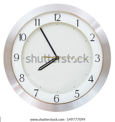 five minutes to eight o clock on the dial round wall clock - stock photo