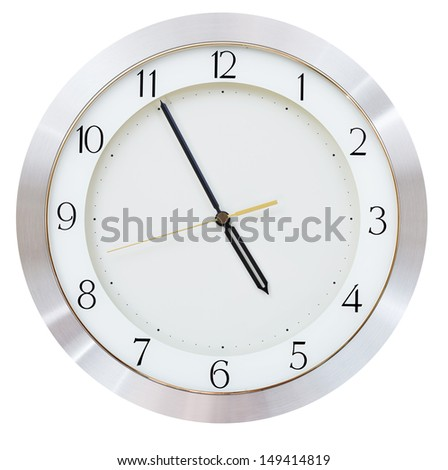 five minutes to five o clock on the dial round wall clock - stock photo