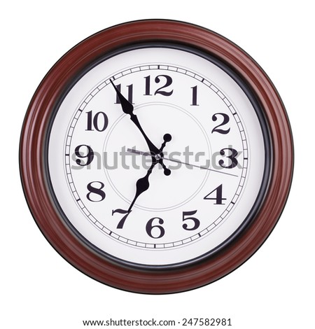 Five minutes to seven on a round clock - stock photo