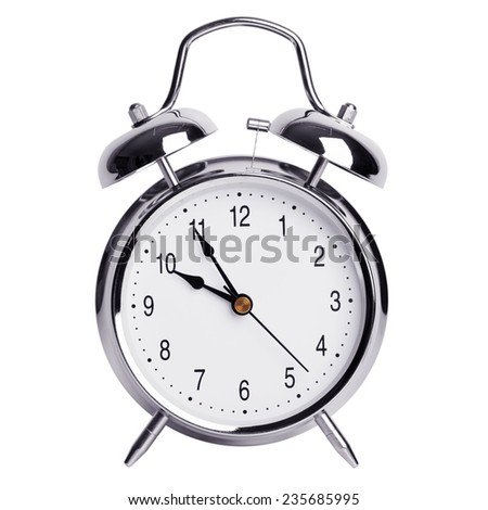 Five minutes to ten on a round alarm clock - stock photo