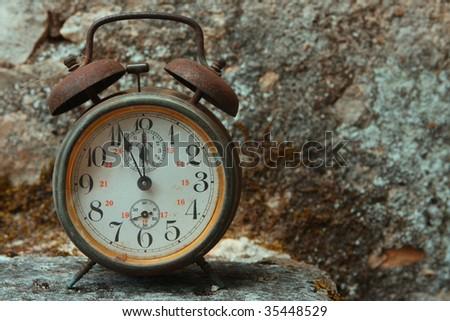 Five minutes to twelve, antique alarm bell - stock photo