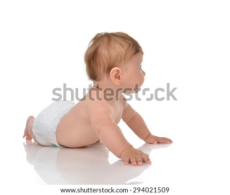 Five month Infant child baby girl in diaper lying happy looking at the corner isolated on a white background - stock photo