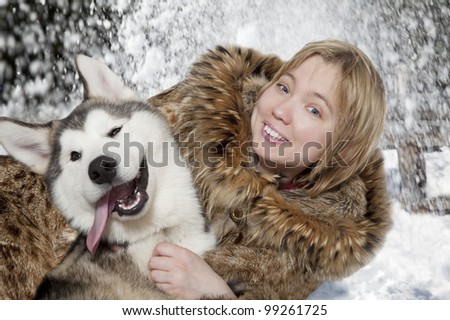 Five month old malamute puppy with young woman - stock photo