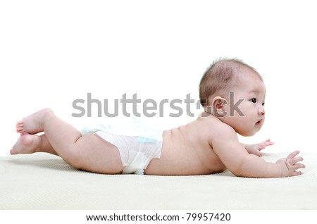 Five months old baby girl happy crawling on bed
