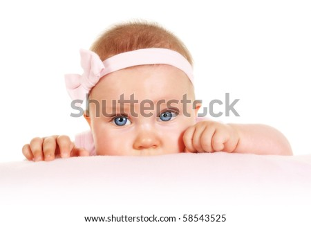 Five months old baby girl with blue eyes peeking - stock photo