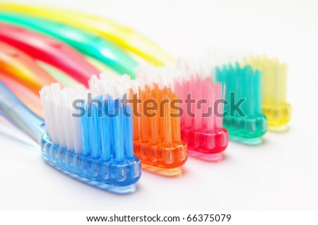 Five multicolored toothbrushes over white background - stock photo