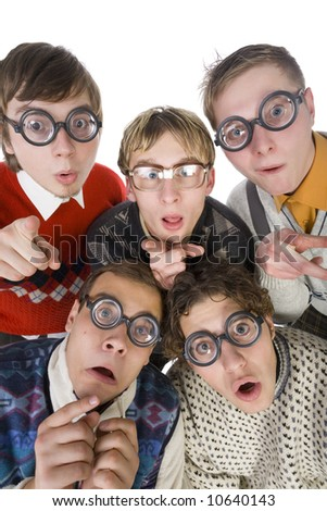 Five nerdy guys in funny glasses, looking and pointing at camera. They are looking scared. Front view, white background - stock photo