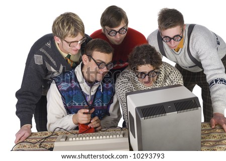 Five nerdy guys playing on old-fashioned computer. They are enjoying it. Front view, white background - stock photo