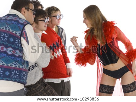 Five nerdy guys standing next to stripteaser. She is smiling but they are looking scared. Side view, white background - stock photo