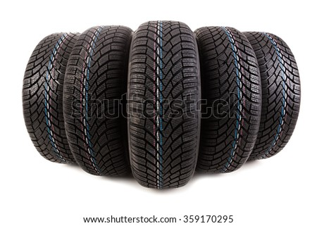 Five new winter tires isolated on white background - stock photo