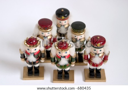 five nutcrackers in a pyramid - stock photo
