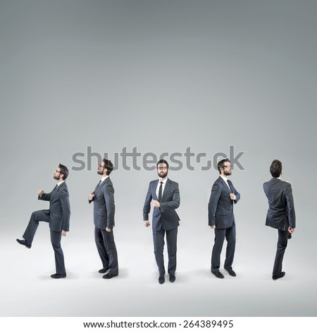 Five office workers moving in various directions