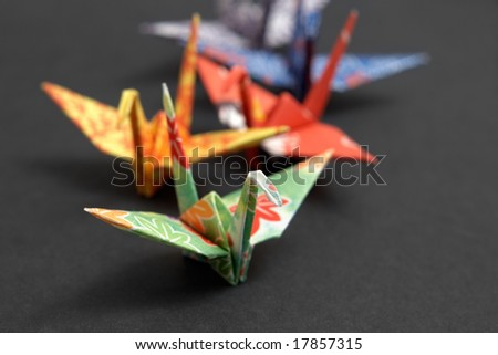 Five origami birds on a black background - stock photo