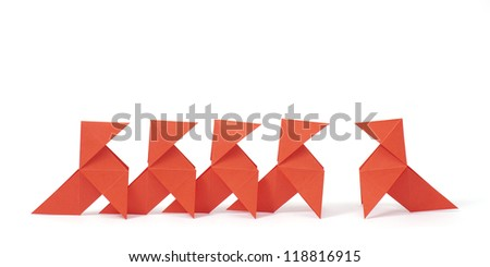 Five origami birds on white background. Concept of being aginst the crowd / individuality / revolution - stock photo
