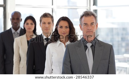 Five Person Business team standing with Serious expressions - stock photo