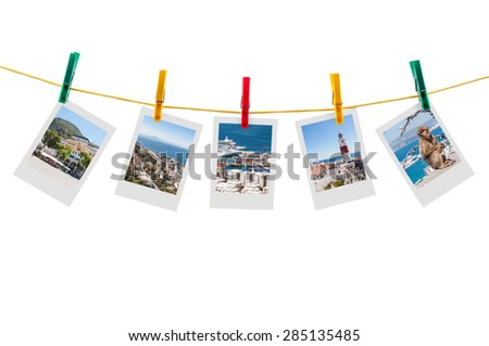 Five photos of Gibraltar on clothesline isolated on white background with clipping path - stock photo