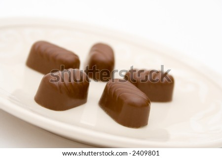 Five pieces of chocolate on plate