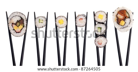 Five pieces of sushi in a row being held up with black chopsticks isolated on a white background. - stock photo